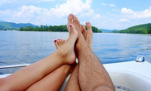 feet on the edge of a boat on Lake Nantahala